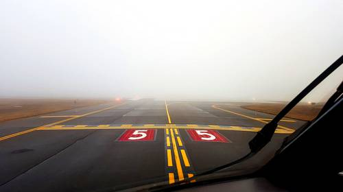 foggy airport cockpit view