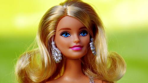 vintage blonde barbie doll with earrings