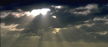 sunlight shining through the clouds