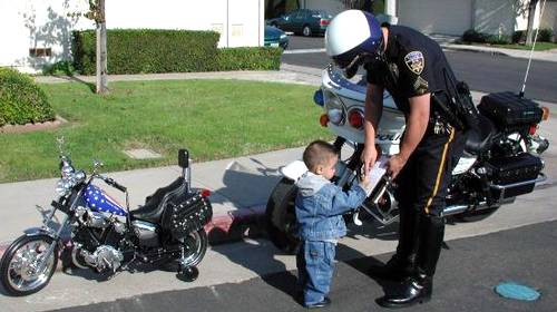 baby mortcycle rider gets a speeding ticket
