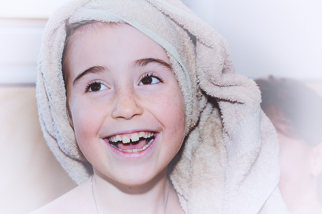smiling child with towel on head