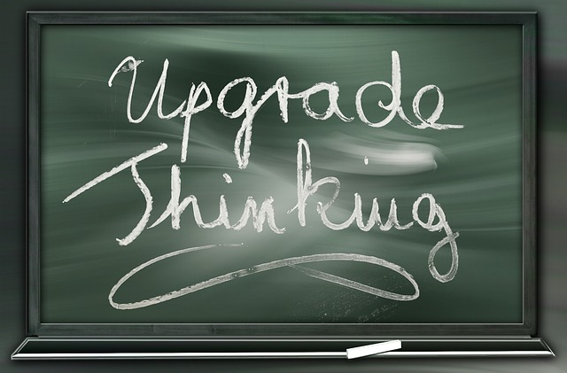 upgrade thinking written with chalk