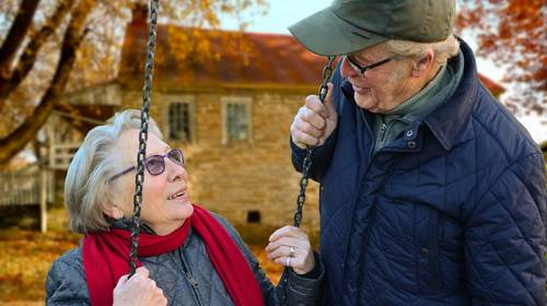 older couple near swingset