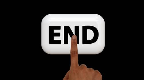 finger pushing the END button