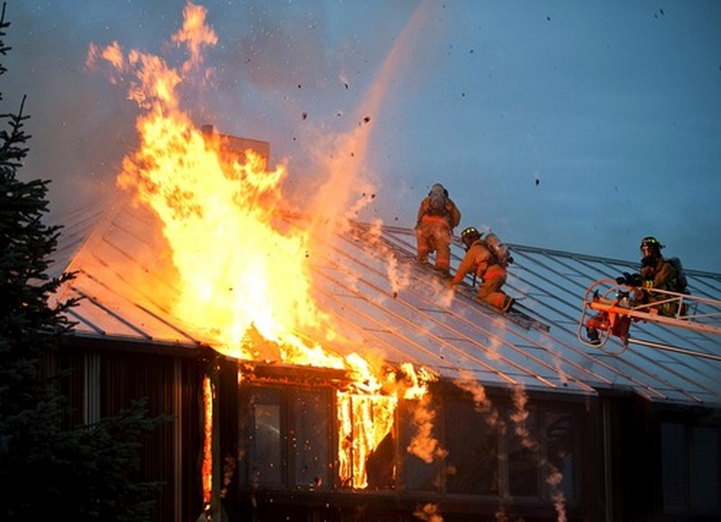 house fire flames with firefighters