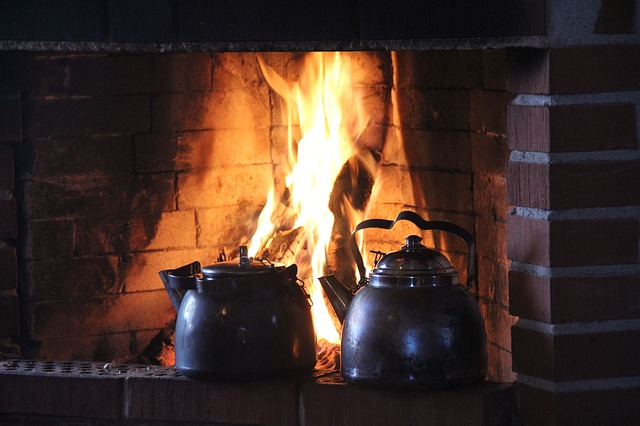 fireplace with kettles