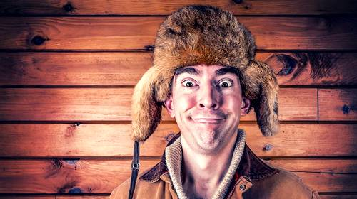 man making a funny face cold weather hat