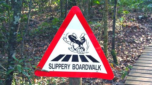 slippery boardwalk sign
