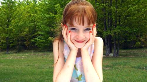 girl red hair hands on cheeks