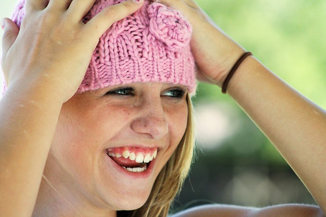 girl pink hat smiling