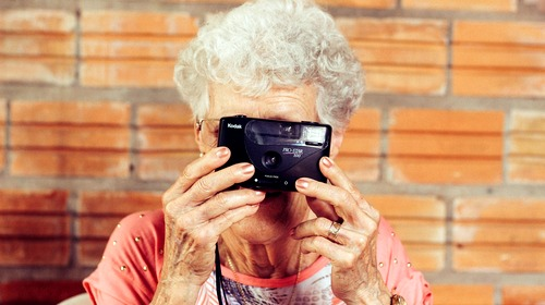 elderly lady with Kodak camera