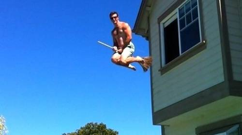 man diving from house to pool