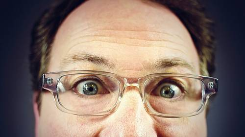 middle aged man extreme close up with glasses