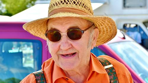 elderly man with sunglasses and straw hat