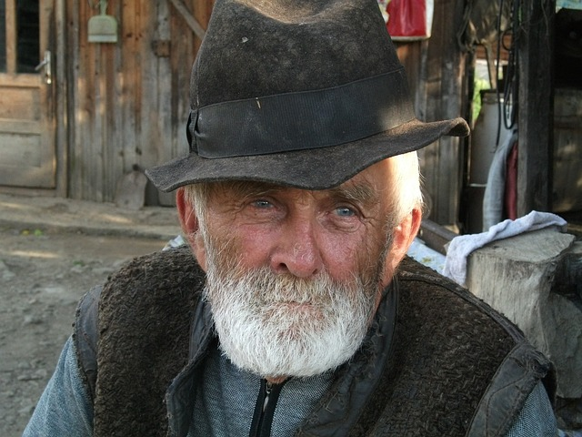 rugged old man with white beard and black hat
