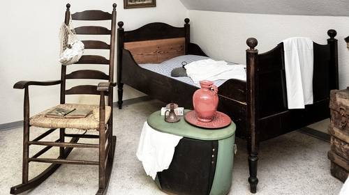 empty rocking chair by bed