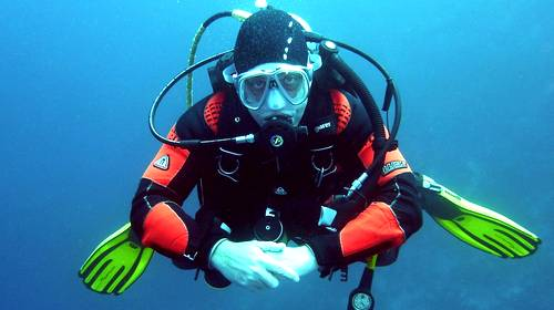 scuba diver swimming straight at the camera