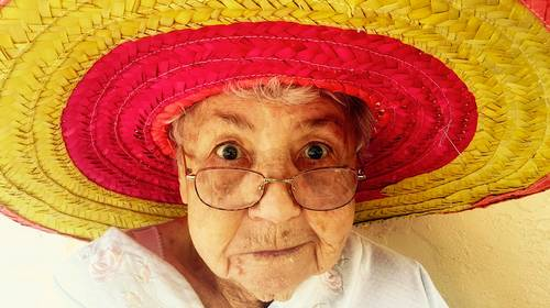 elder woman in sombrero hat