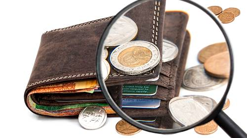 wallet with cash coins and credit cards