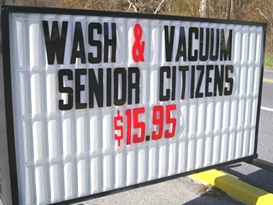 wash and vacuum senior citizens sign