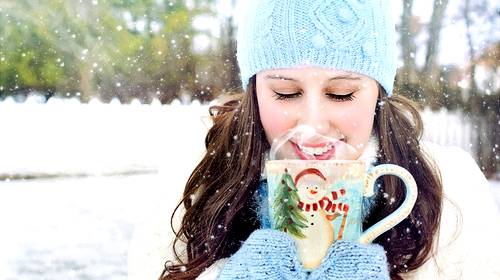 girl in snow with hot chocolate